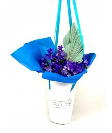 Purple potted flowers in elegant pot