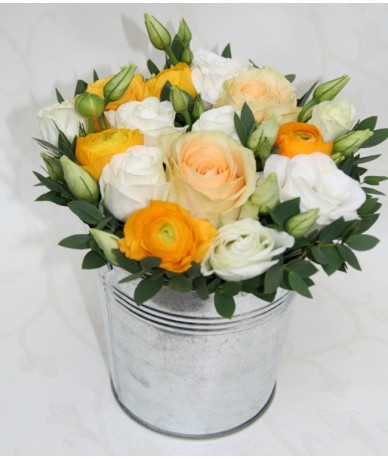 Cut flowers in silver pot