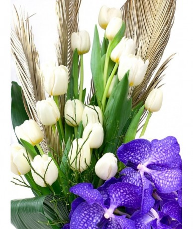 Exotic bouquet from orchids and tulips