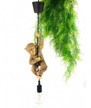 Mennyezeti lámpazsinóron hintázó arany majom lámpadekoráció, a zsinór és a foglalat fekete