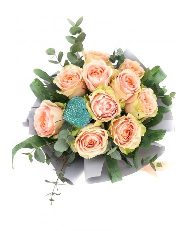 Cream roses in round bouquet and with light blue heart decor