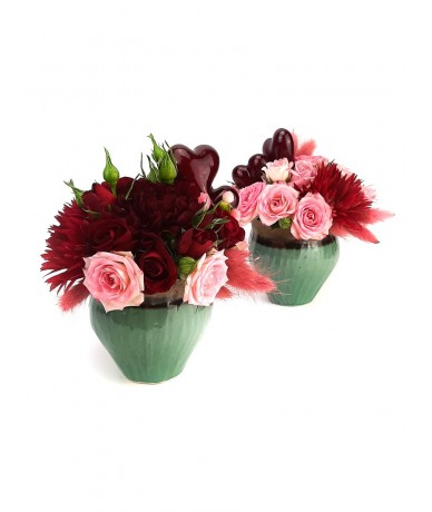 lovely flower composition with red flowers and small pot