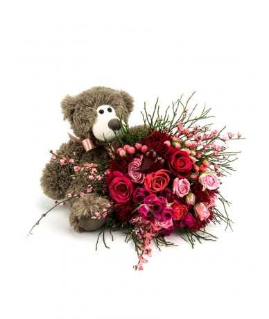 Bouquet of red -pink flowers, with a sweet teddy bear