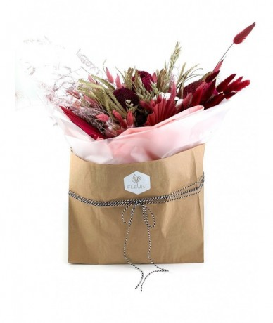 Naturalistic pink composition in a trendy paper bag