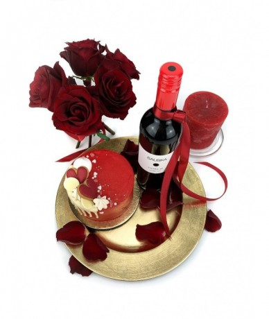 Gift package with red roses, a bottle of quality red wine, candle and a mini cake from Cake Shop