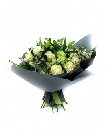 Garden roses, wax flowers and lilies in a hand tied bouquet