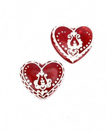 Handmade gingerbread heart in red decorated with white Hungarian motives