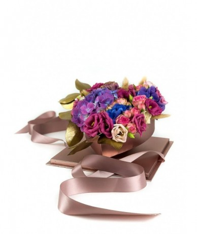 Rose-coloured box hide a heart-shaped bed of flowers