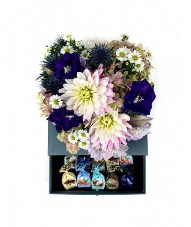Mixed flowers in an elegant heart-shaped blue box with a drawer