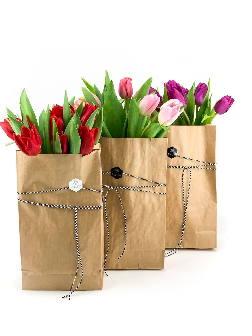 10 fresh tulips in a trendy paper bag in a mix of colours