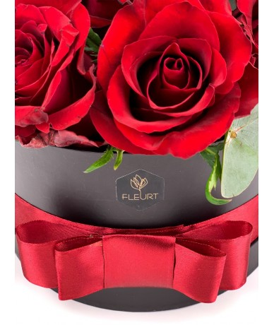 Elegant black round flower box with red roses