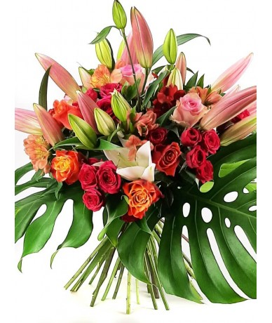 Round, large bouquet of lilies and lovely roses