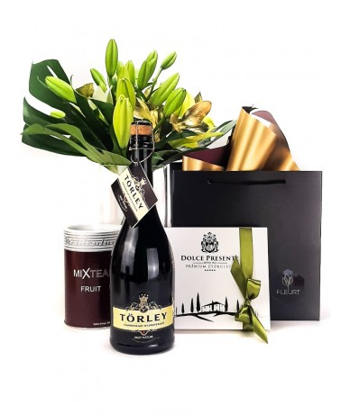 Gift pack for men with lilies, chocolates, champagne and tea